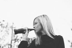 Woman in Black Long Sleeve Shirt Drinking Soda Stock Photo