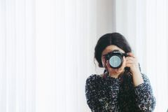 Woman in Black Long-sleeved Shirt Using Camera Stock Image