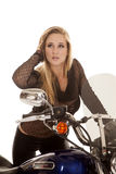 Woman in black look side by motorcycle Royalty Free Stock Images
