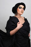 Woman with black make-up and scarf Royalty Free Stock Images