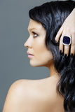 Woman with black manicure. Woman with black hair and ring on black manicure hand, from 16Bit RAW Royalty Free Stock Images