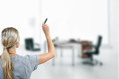 Woman with black marker in the hand Stock Photography