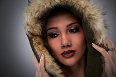 Woman on Black Mascara Red Lipstick Cover Her Face With Brown Fur Coat Royalty Free Stock Image