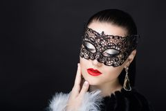 Woman with black mask. Beauty portrait beautiful woman girl lady model red lips and tightly tied brunette hair. Professional makeup studio. New big carnival mask stock photography
