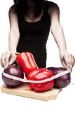 Woman in black measuring vegetables Royalty Free Stock Photography