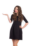 Woman in Black Mini Dress Presenting Something Royalty Free Stock Photography