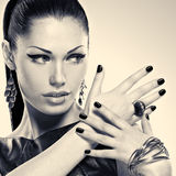 Woman with black nails and with stylish bijouterie Royalty Free Stock Photos