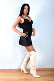 Woman in black outfit and white boots Royalty Free Stock Photos