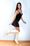 Woman in black outfit and white boots Royalty Free Stock Photo