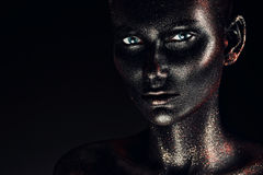 Woman in black paint with silver glitter Royalty Free Stock Images