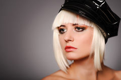 Woman with black peaked cap Royalty Free Stock Photos