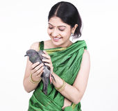 Woman with a black pigeon Stock Images
