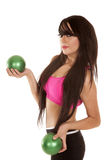 Woman black and pink fitness green balls side Stock Photo