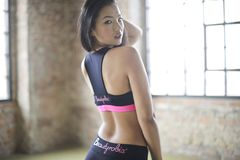 Woman in Black and Pink Sports Bra Stock Photography