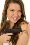 Woman with a black pistol devious smile Stock Photography