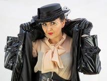 Woman in black PVC mac wearing a hat Stock Photos
