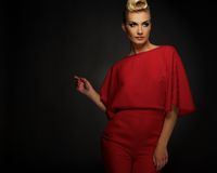 Woman in black red indoors. Fashionable woman in red with creative hairstyle Royalty Free Stock Photo