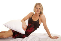 Woman black and red nightgown lay hold pillow Royalty Free Stock Photography