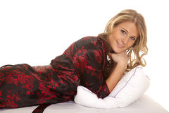 Woman black and red nightgown lay in robe smile Stock Photos