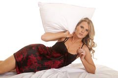 Woman black and red nightgown lay on side pillow over head Royalty Free Stock Photo