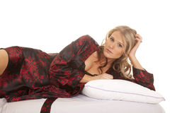 Woman black and red nightgown lay side robe look Stock Photo