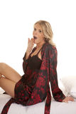 Woman black and red nightgown and robe yawn Royalty Free Stock Images
