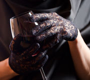 Woman in black  with red wine Stock Photos
