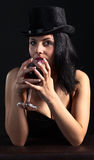 Woman in black  with red wine Royalty Free Stock Images