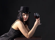 Woman in black  with red wine Royalty Free Stock Image