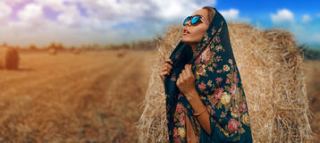 Woman in black russian shawl In Harvested Field Stock Images