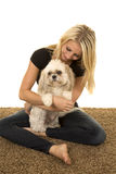 Woman black shirt with dog on lap sitting Stock Photography