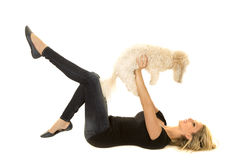 Woman black shirt with dog lay on back hold up Royalty Free Stock Photos