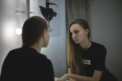 Woman in Black Shirt Facing Mirror Royalty Free Stock Images