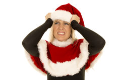 Woman in black shirt and santa hat frustrated Royalty Free Stock Photo
