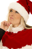 Woman in black shirt and santa hat look up close Stock Photography