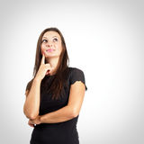 Woman in black shirt thinking portrait Royalty Free Stock Images