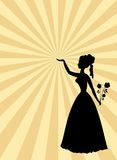 Woman black silhouette on beige and gold rays patterned background.  Royalty Free Stock Photo