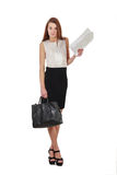 Woman in black skirt holdding bag and documents over white Royalty Free Stock Photography