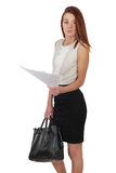 Woman in black skirt holdding bag and paper documents over white Royalty Free Stock Photos