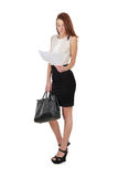 Woman in black skirt holdding bag and reading documents over whi Stock Image
