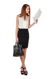 Woman in black skirt holdding bag and reading documents over whi Royalty Free Stock Photography