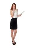 Woman in black skirt holding paper document over white Stock Photo