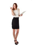 Woman in black skirt holding paper documents over white Stock Image