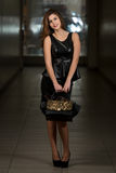 Woman In Black Skirt And Leather Peplum Top Stock Photography