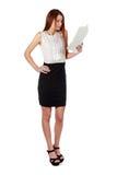 Woman in black skirt reading document over white Stock Image