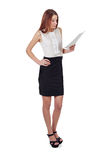 Woman in black skirt reading document over white Royalty Free Stock Photo