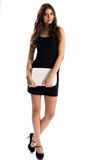 Woman in black sleeveless dress. Royalty Free Stock Images