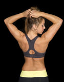Woman in black sports bra from back look hands in hair Stock Photos