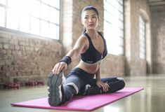 Woman in Black Sports Brassiered and Black Pants Doing Yoga Royalty Free Stock Photography