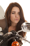 Woman in black stand by motorcycle look mirror Stock Images
